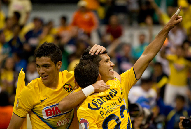 America's Jesus Molina, right, celebrates with his teammates after his goal Sunday put the club in position to win a record 12th domestic title in Mexico.