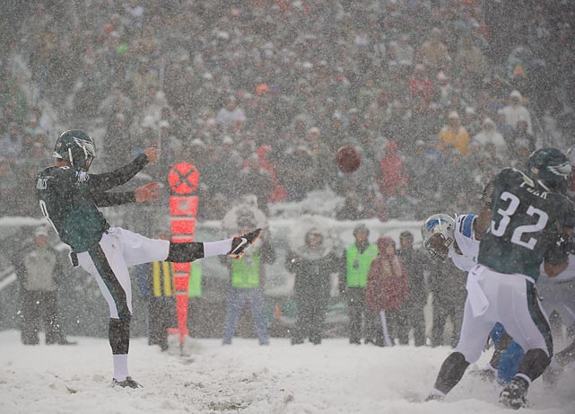 Philadelphia Eagles punter Donnie Jones gets one off amid heavy snowfall during the Eagles' game against the Detroit Lions in Philadelphia on Sunday. After a terrible start in the blizzard, the Eagles rallied to win 34-20.