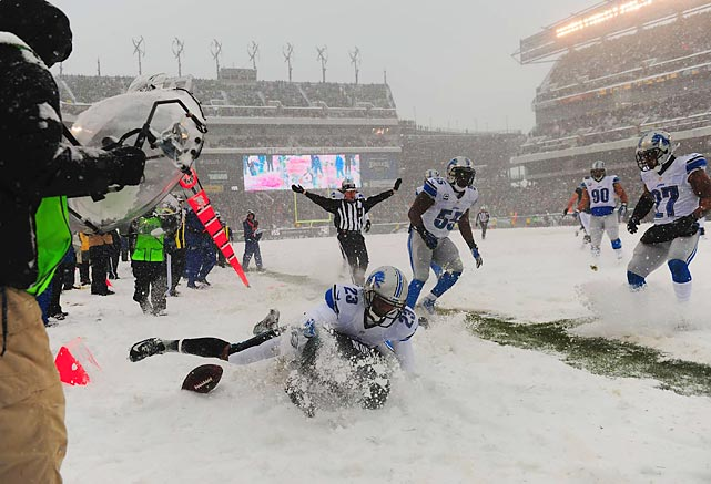 Detroit Lions cornerback Chris Houston tackles Philadelphia Eagles wide receiver DeSean Jackson into the snow to force an incompletion Sunday in Philadelphia. Jackson finished the game with four catches for 59 yards, including the lone receiving touchdown of the game.