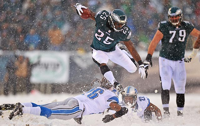 Philadelphia Eagles running back LeSean McCoy hurdles Louis Delmas and Glover Quin of the Detroit Lions as snow cascades in Philadelphia on Sunday. While Lions defenders slipped and slid in the powder, McCoy had no trouble dashing through the snow, setting an Eagles franchise record with 217 rushing yards in the win.
