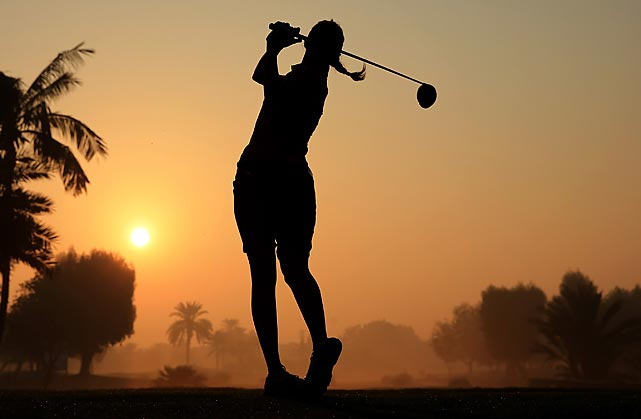 Paula Hurtado takes a practice swing as the rising sun glints through the morning fog in Dubai, United Arab Emirates, on Dec. 4. The Colombian missed the cut at the 2013 Omega Dubai Ladies Masters, which Pornanong Phatlum won at 15-under.