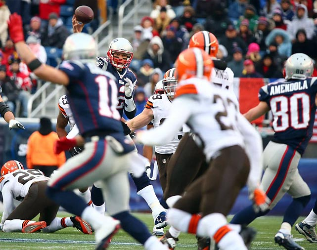 New England Patriots quarterback Tom Brady releases a pass against the Cleveland Browns on Sunday. Brady rallied the Patriots on an improbable comeback, tossing two touchdown passes in the final 1:01 to steal a 27-26 win in Foxboro.