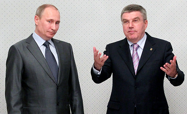 IOC President Thomas Bach (right) says Russian President Vladimir Putin promised him there would be no discrimination against athletes or spectators at the Sochi Olympics.