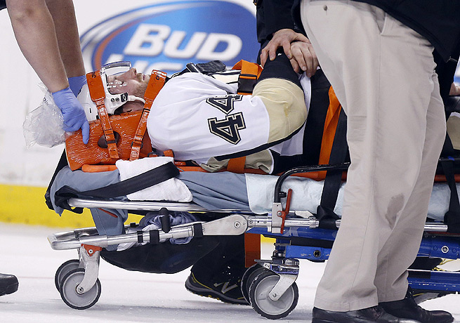 Brooks Orpik was carted off the ice after being jumped by the Bruins' Shawn Thornton.