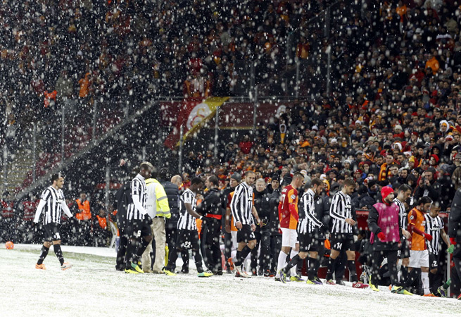 Juventus and Galatasaray players walk off the snowy field in Istanbul as their vital Champions League match was halted on Tuesday.