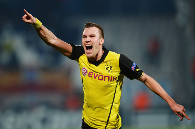 Kevin Grosskreutz celebrates his goal that lifted Borussia Dortmund from elimination to the top of the Champions League's Group F and into the knockout stage.