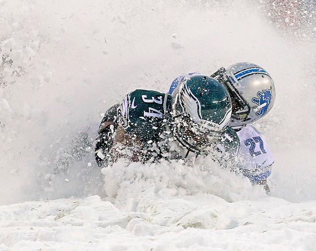 Snow job: Bryce Brown of the Eagles and Glover Quin of the Lions frolic in the winter wonderland that was Lincoln Financial Field in Philadelphia, where it apparently isn't always sunny.