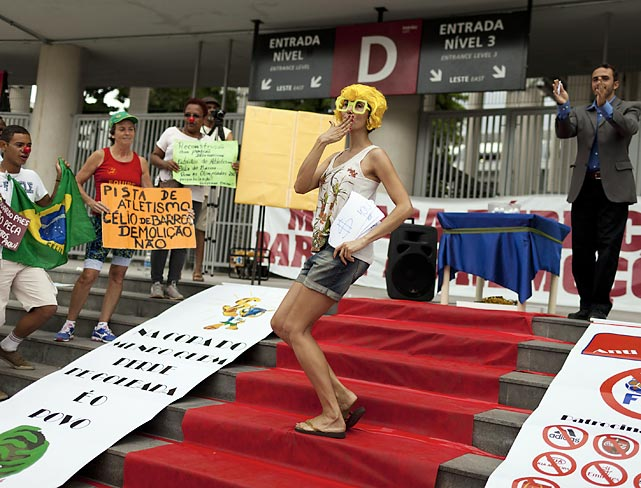 Kiss your money goodbye: Demonstrators gathered outside the Maracana Stadium in Rio de Janeiro, Brazil (site of next year's World Cup Final soccer match) to poo-pooh the cost of staging the event and accuse politicians and FIFA of profiting at the expense of Brazilian taxpayers, as if that could ever happen.