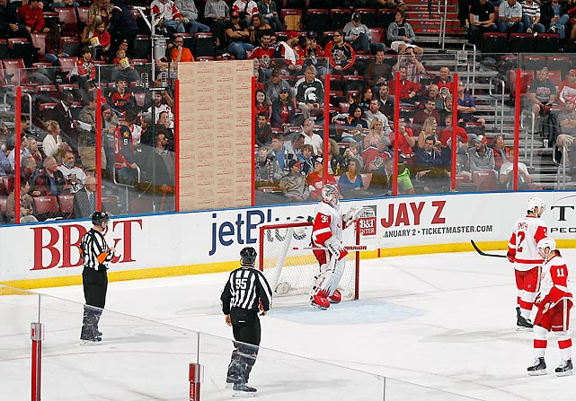 This season, the woeful Florida Panthers have had a hard time drawing flies to their games, let alone fans. So why not make it harder for those (fans, not flies) who do show up -- especially the ones who fork over $300 a seat -- to view the action? During a sparsely attended game against the Detroit Red Wings at the BB&T Center in Sunrise, Fla, a shot broke the glass and alas the crew couldn't get the protective paper off the new sheet, so they simply left it on, much to the dismay of the paying customers who were forced to move. Fortunately, they had plenty of empty seats from which to choose.