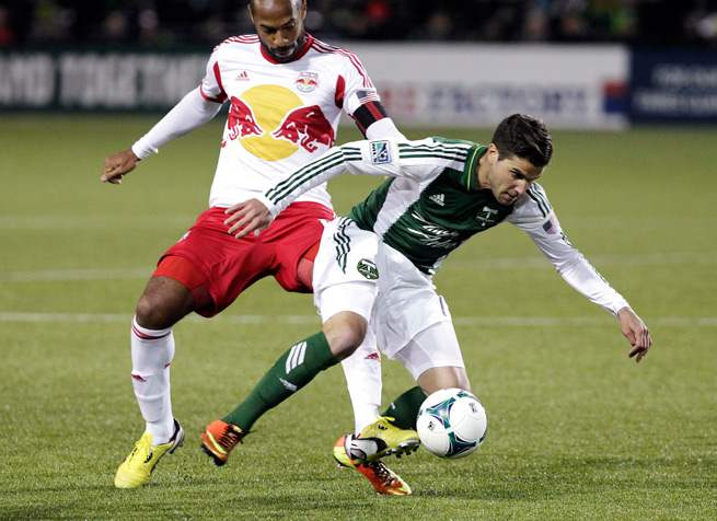 Winger Sal Zizzo, right, is headed to MLS Cup champion Sporting Kansas City from the Portland Timbers after a Friday trade.