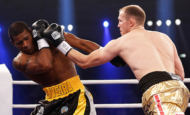 Juergen Braehmer battered Marcus Oliveira to take the vacant WBA world light heavyweight title.