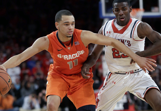 Tyler Ennis (11) and Syracuse withstood a late run by St. John's in a 68-63 win in New York.