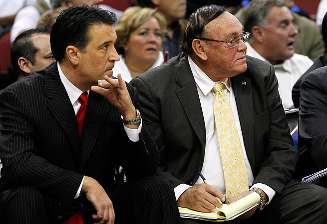 Although Gene Keady (right) can't work with players in games, he offers insights to Lavin (left) and his coaches.