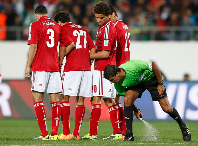 Referee Sandro Ricci uses vanishing spray in the FIFA Club World Cup to mark off where the wall should stand on a free kick. The same spray will be used at this summer's World Cup.