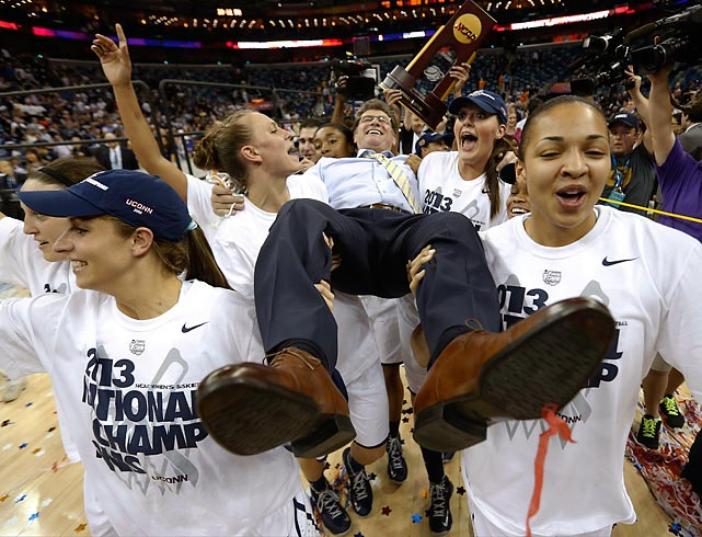 Connecticut players celebrate as they carry their head coach Geno Auriemma after defeating Louisville 93-60 in the women's national championship game.