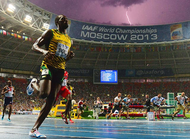 Jamaica's Usain Bolt wins the 100 metres final at the 2013 IAAF World Championships while a lightning bolt strikes in the sky. Bolt timed a season's best 9.77 seconds, with American Justin Gatlin claiming silver in 9.85sec and Nesta Carter, also of Jamaica, taking bronze in 9.95sec.