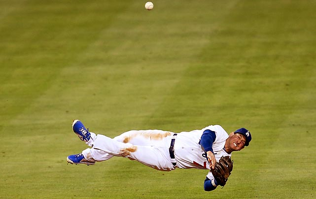Dodgers shortstop Nick Punto dives for a ground ball in the fifth inning of LA's 2-1 loss to the Braves on June 8.