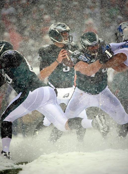 Eagles' Nick Foles gets set to pass in the snow against the Lions on December 8.