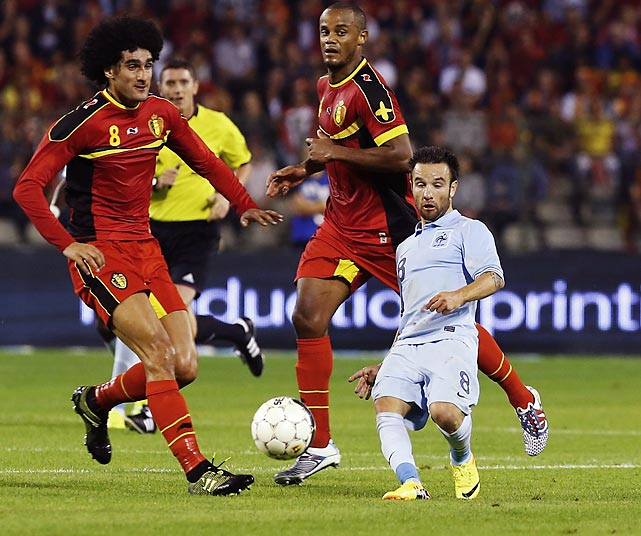 "France's Mathieu Valbuena (R) is challenged by Belgium's Marouane Fellaini (L) and Vincent Kompany (C) during their international friendly soccer match in Brussels on August 14, 2013. An optical illusion created by Valbuena leaning way back makes him look very short - when he's actually 5'6"" tall."