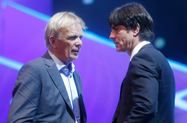 Cameroon's German manager Volker Finke, left, and Germany manager Joachim Low talk at the FIFA World Cup draw. Their teams will meet in a pre-World Cup friendly on June 1.
