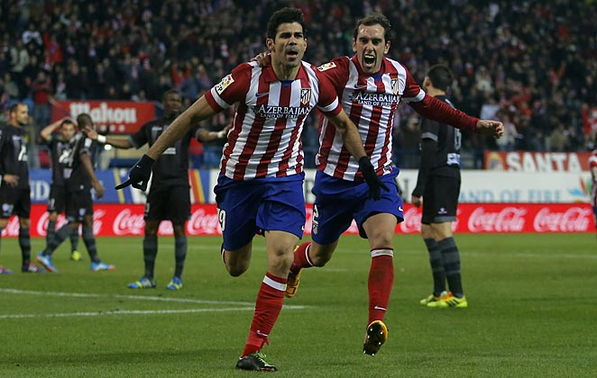 Diego Costa scored two goals against Levante to keep Atlético Madrid near the top of the La Liga table.