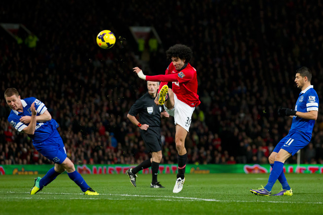 Manchester United midfielder Marouane Fellaini, center, is facing a six-week layoff after wrist surgery.