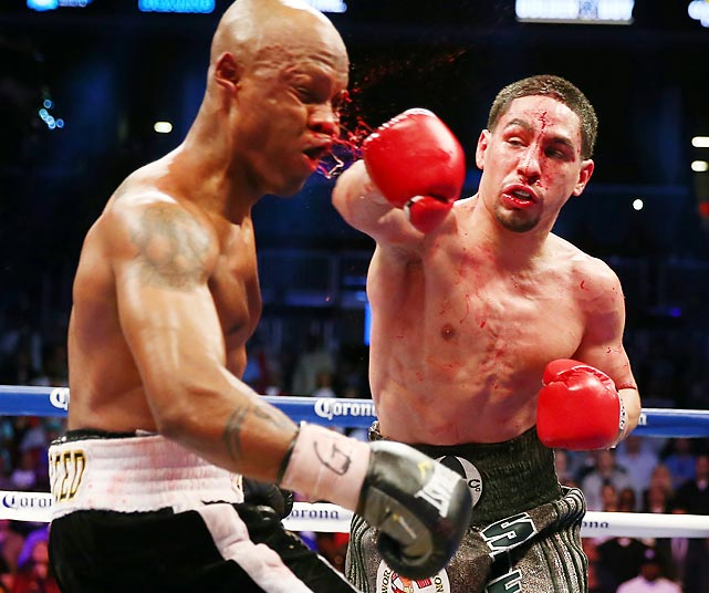 Danny Garcia lands a big hit on Zab Judah under the lights of the Barclay's Center in Brooklyn on his way to winning the WBA Super and WBC Super Lightweight title fight in 12 rounds on April 27.