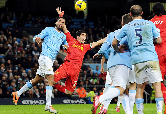 Liverpool's late shout for a Joleon Lescott foul on Luis Suarez in the box went unheard in the Reds' 2-1 loss at City.