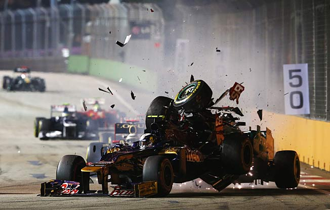 Michael Schumacher (right) fearlessly survived wrecks like this one in the 2012 Singapore Grand Prix.