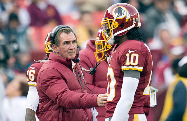 Tension mounted between Mike Shanahan (left) and Robert Griffin III all year, culminating in RGIII's benching.