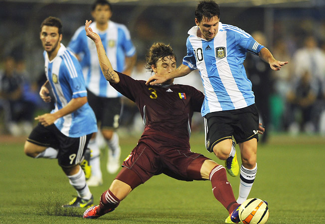 Lionel Messi wins the ball from Venezuela's Ternando Amorebita during a friendly in Kolkata.