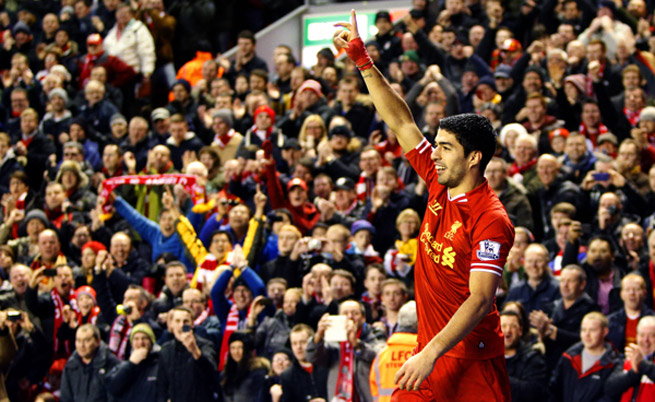 Luis Suarez celebrates his 20th goal of the Premier League campaign, one that helped Liverpool to a 2-0 win over Hull City on Wednesday.