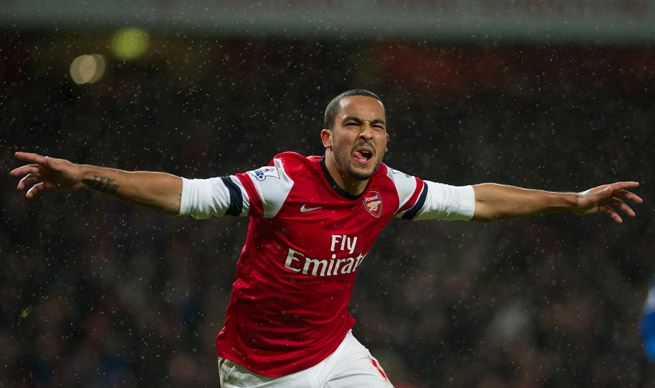 Theo Walcott celebrates his goal in Arsenal's 2-0 win over Cardiff City Wednesday.