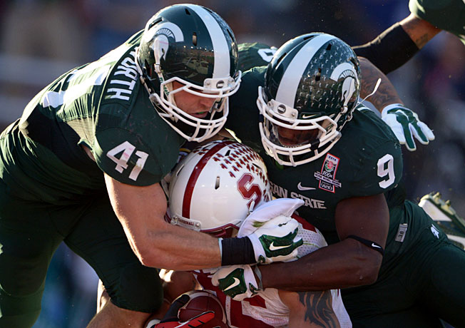 Kyler Elsworth (41), Isaiah Lewis and Michigan State's defense shut down Stanford in the second half.