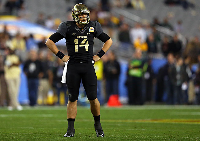 Bryce Petty and Baylor looked on in disbelief as UCF rolled to a surprising 52-42 win in the Fiesta Bowl.