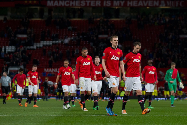 Manchester United players dejectedly walk off the field following a 2-1 FA Cup loss to Swansea City.