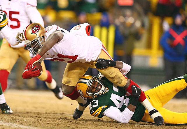 San Francisco 49ers running back Frank Gore tries to break the tackle of Green Bay Packers safety M.D. Jennings in an NFC wild-card playoff game. Gore finished with 66 yards rushing and a touchdown, helping the 49ers to their 23-20 victory.