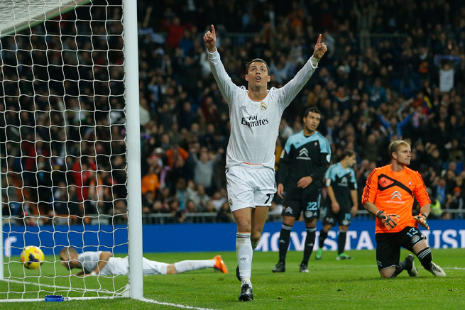 Cristiano Ronaldo celebrates after scoring one of his two goals in Real Madrid's 3-0 win over Celta Vigo on Monday.