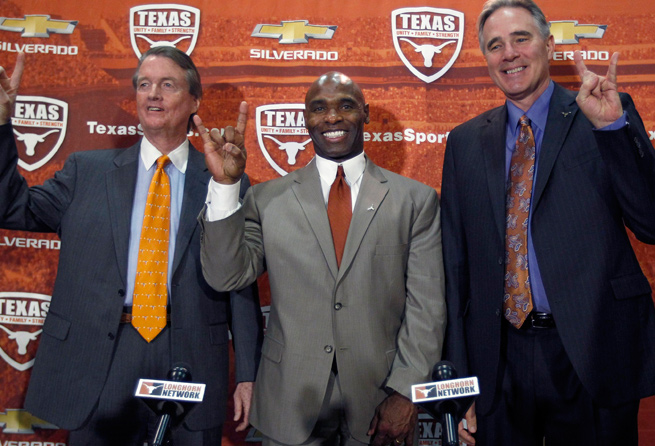 Charlie Strong (center) replaces Mack Brown as the head coach at Texas after two years with Louisville.