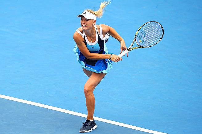 Despite a close second-set tiebreaker, Caroline Wozniacki lost in straight sets to Lucie Safarova.