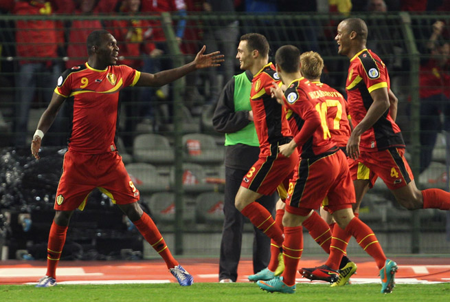 Belgium's multi-national makeup includes Kinshasa-born forward Christian Benteke, left, and captain Vincent Kompany, far right, whose father migrated from the Congo.