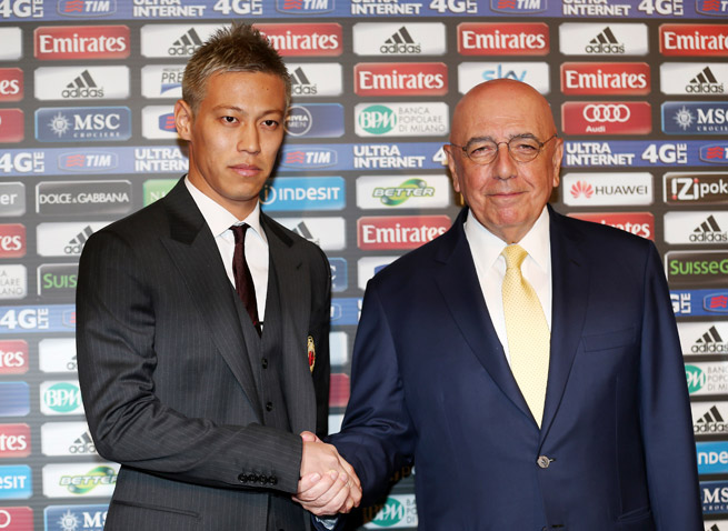 Japan star Keisuke Honda, left, poses with AC Milan CEO Adriano Galliani prior to being introduced as the Italian power's new signing.