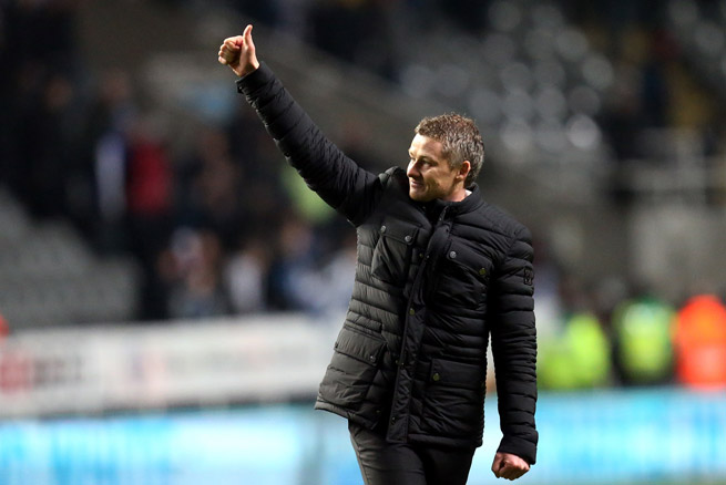 New Cardiff City manager Ole Gunnar Solskjaer celebrates after notching an FA Cup victory over Newcastle in his first game in charge.