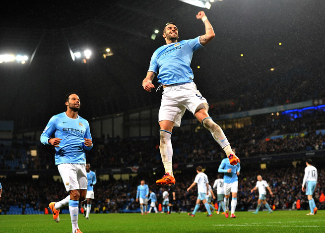 Alvaro Negredo celebrates the completion of his hat trick in Manchester City's 6-0 rout of West Ham in the first leg of their League Cup semifinal.