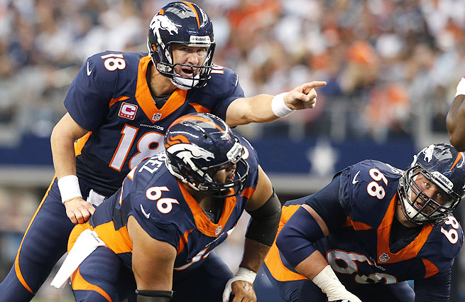 The Broncos' offensive line has allowed Peyton Manning (top) to be sacked just 18 times this season.