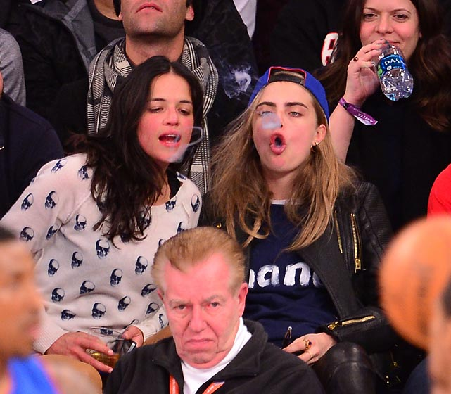 Talk about two smokin' babes. The actress and the Victoria's Secret model (who recently stirred hearts across the land by sharing a tongue sandwich with Miley Cyrus) were spotted getting rather, shall we say, <italics>cozy</italics>, at the Pistons-Knicks tilt at Madison Square Garden. Here they are sharing a post-canoodle cheroot.