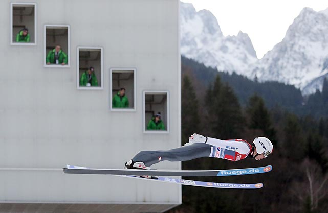 Austria's Thomas Diethart goes flat out by the judges tower during the second stage of the four hills tournament in Garmisch-Partenkirchen, Germany.