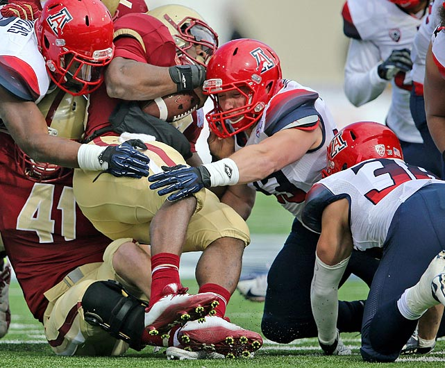 Facing the nation's leading rusher in the AdvoCare V100 Bowl, Fischer and the Wildcats' defense were nearly perfect. The linebacker made 14 tackles, including 1.5 for loss, and had one sack while helping to hold Boston College running back Andre Williams to 75 rushing yards in Arizona's 42-19 victory.