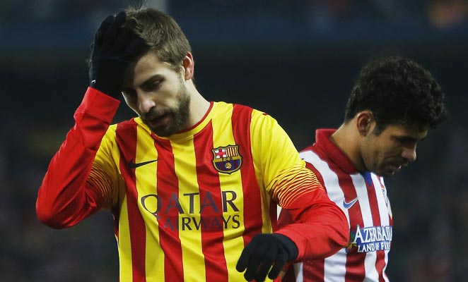 Barcelona's Gerard Pique (left) was able to hold the red-hot Diego Costa in check on Saturday.