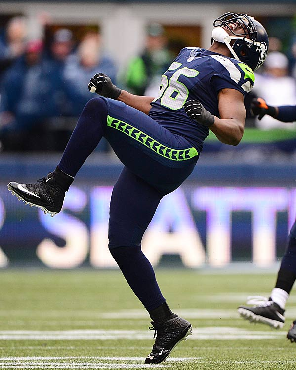 Cliff Avril celebrates a good play as the Seahawks paved their way to the NFC Championship game.